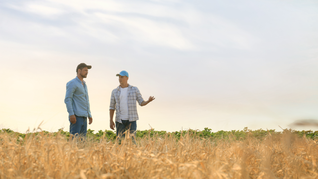 Image of farmer customer talking to an employee on farm sized